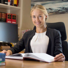 Lauren Ticehurst sitting at her desk at Newcastle Chambers