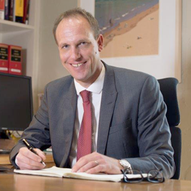 Stefan Muller sitting at his desk at Newcastle Chambers